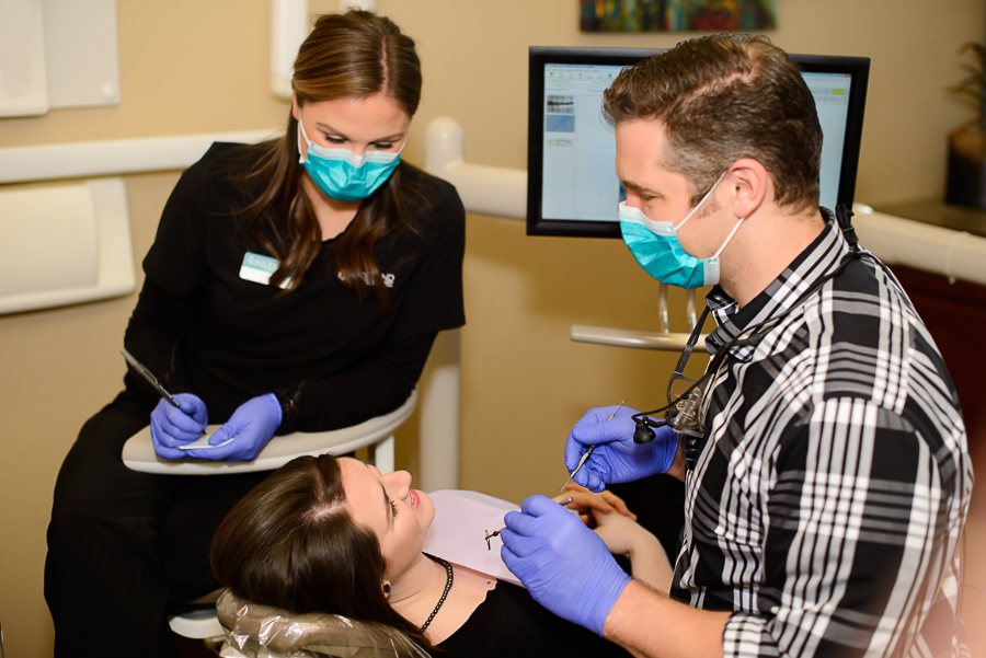 Dr. David explains the dental veneers treatment procedure to a patient at Woodland Family Dental.
